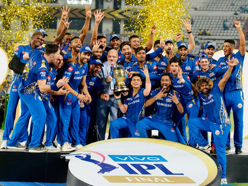 Mumbai Indians players celebrate with the trophy