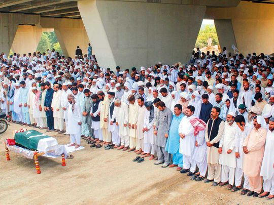 Residents offer prayers at the funeral