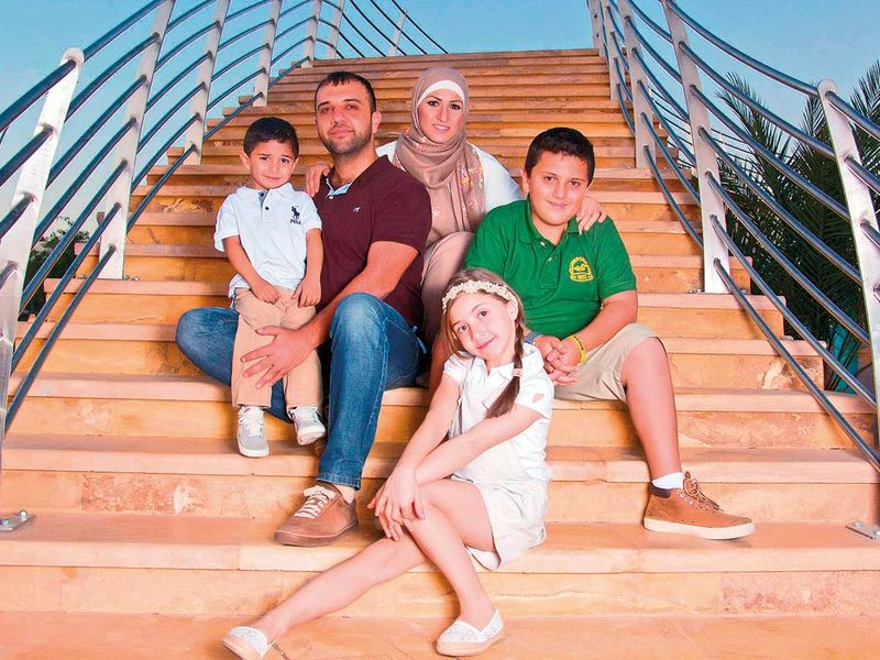 Abla Ahmad Bassa and husband Mohammad with three kids Fares (Left) Hana (middle) and Omar (right)