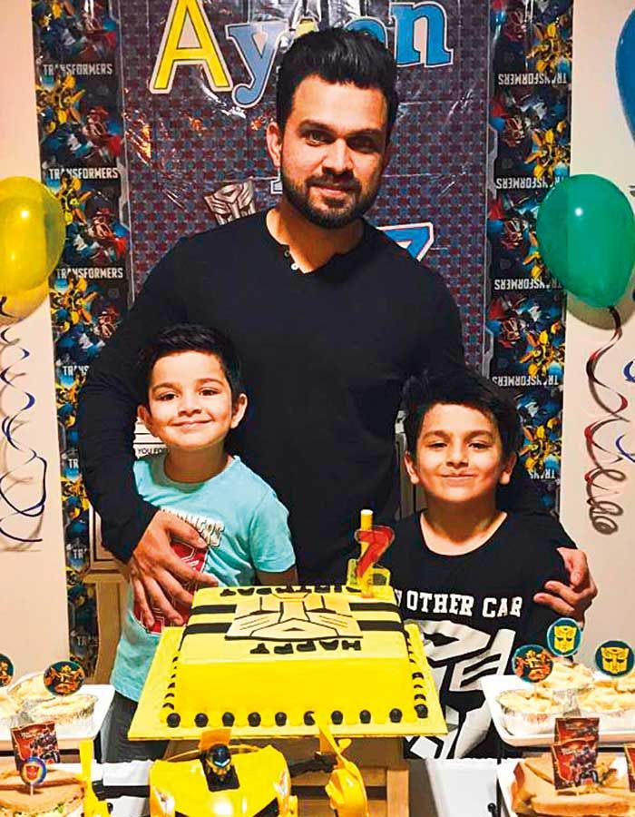 Arif Ashraf with two sons Ayaan Asif (7, right) and Rayaan Asif (4, left)