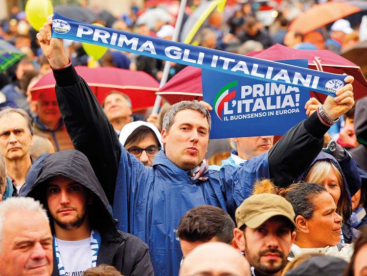 People attend a rally organised by League leader Matteo Salvini