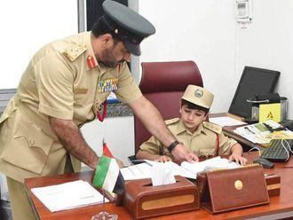 Boy police officer in Dubai