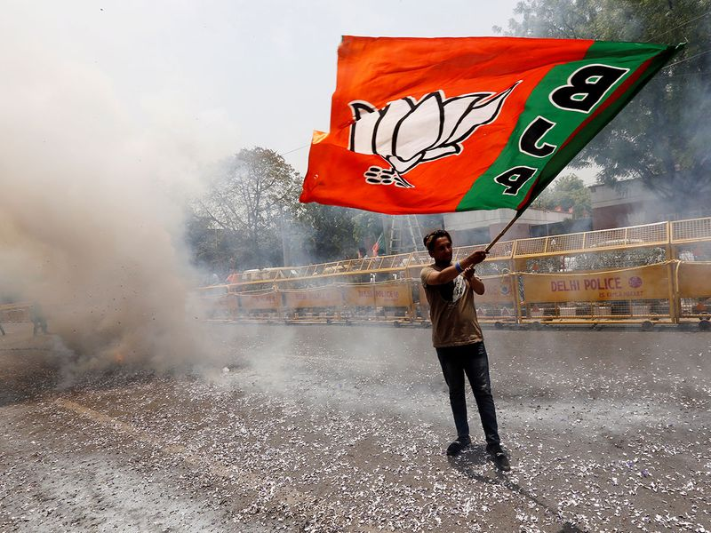 A BJP supporter waves a party flag