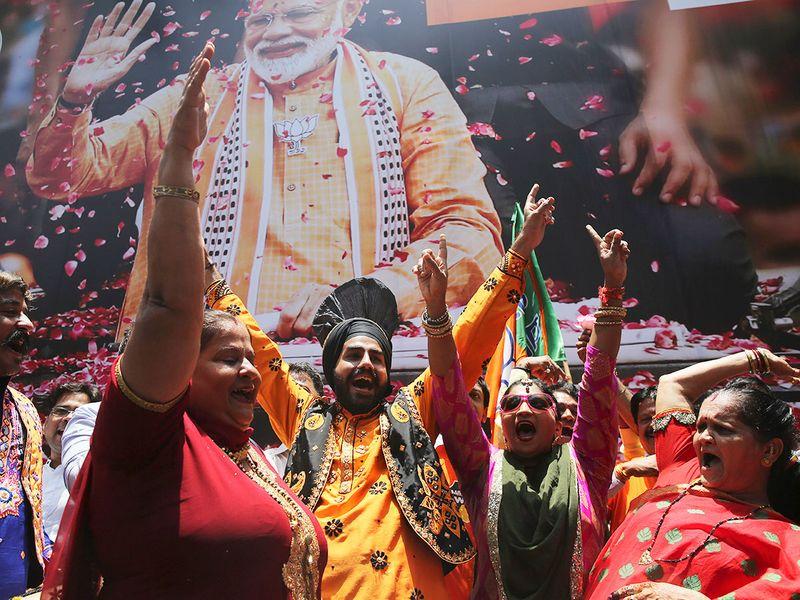 BJP workers celebrate outside BJP headquarters in Mumbai