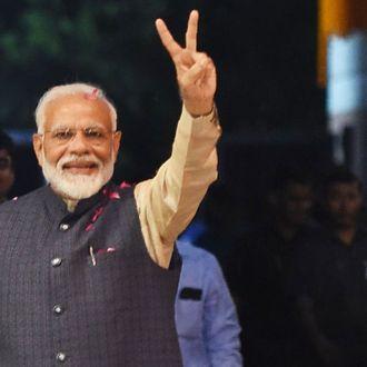 Prime Minister Narendra Modi flashes the victory sign