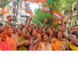 Supporters of BJP shout slogans and hold party flags