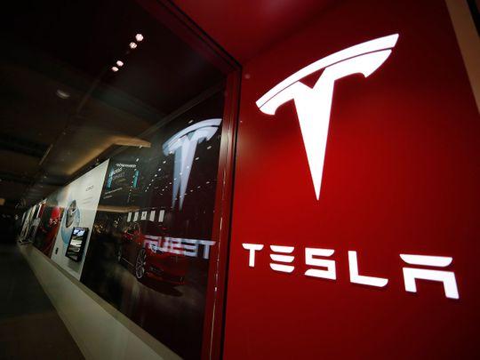 Tesla races past $100 billion in market valuation