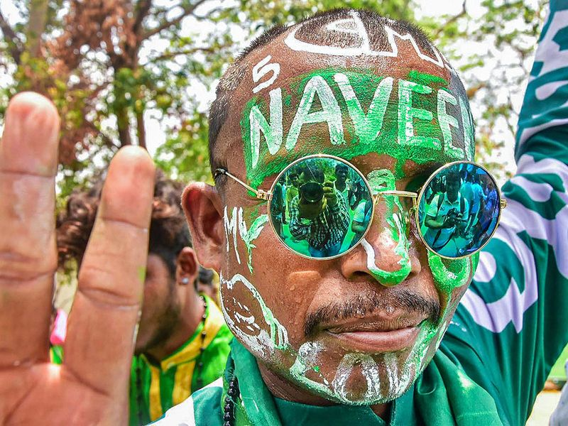 A Biju Janata Dal (BJD) supporter flashes the victory sign