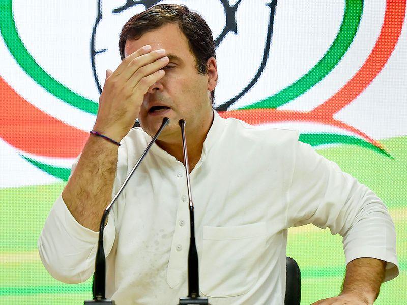 Congress President Rahul Gandhi reacts