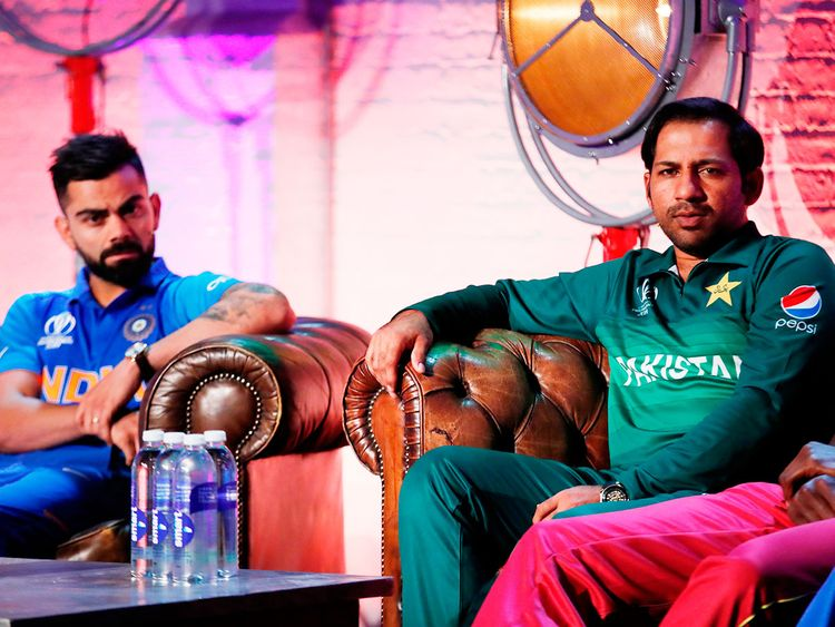 India's Virat Kohli (left) and Pakistan's Sarfraz Ahmad
