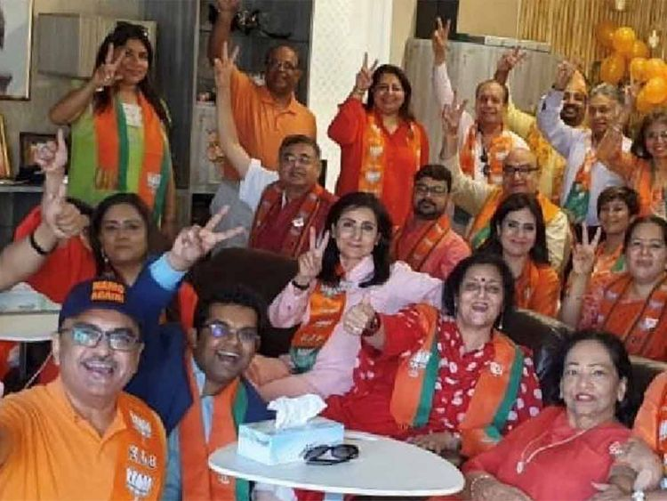 NRI supporters of Modi celebrating BJP victory in a Dubai villa
