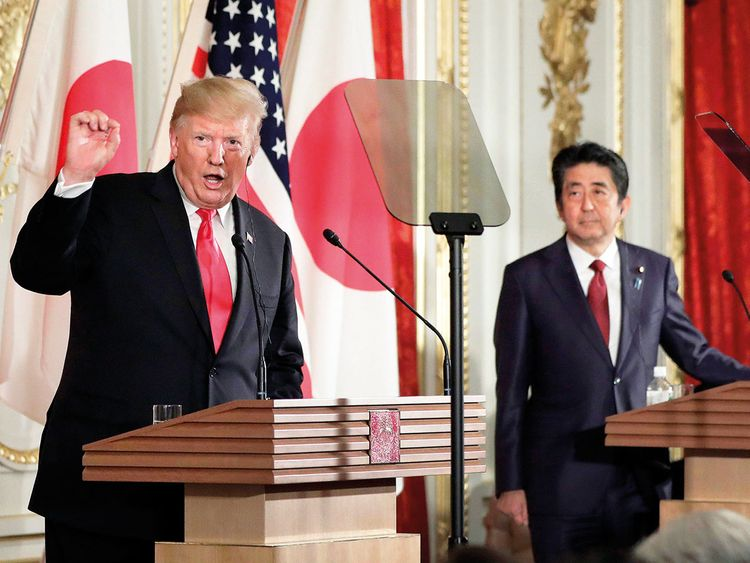 Donald Trump speaks as Shinzo Abe