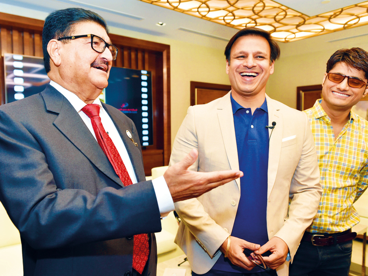 Vivek Oberoi with UAE businessman BR Shetty and 'PM Narendra Modi' producer Sandip Ssingh.