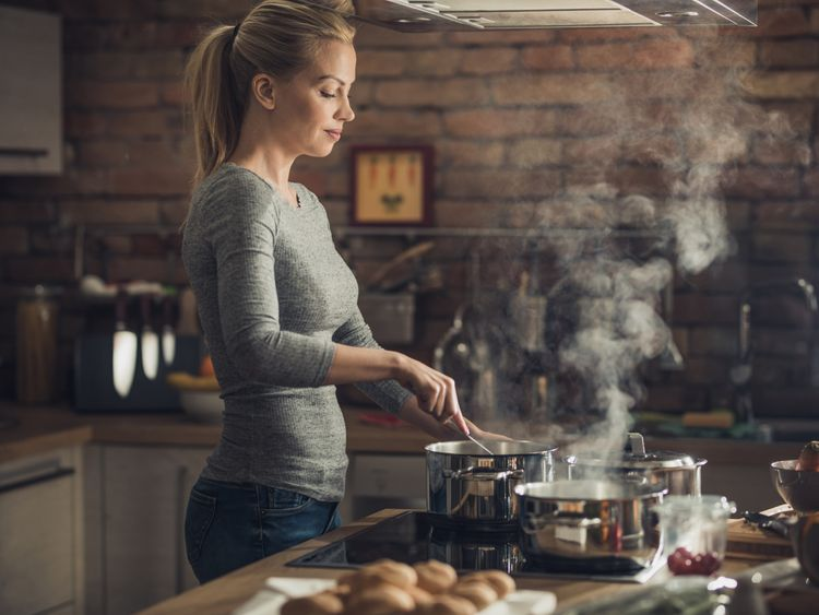 OPN  Lady cooking in kitchen-1559215281657