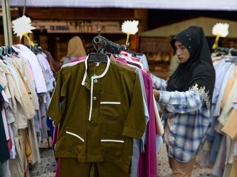 A woman looking at clothings