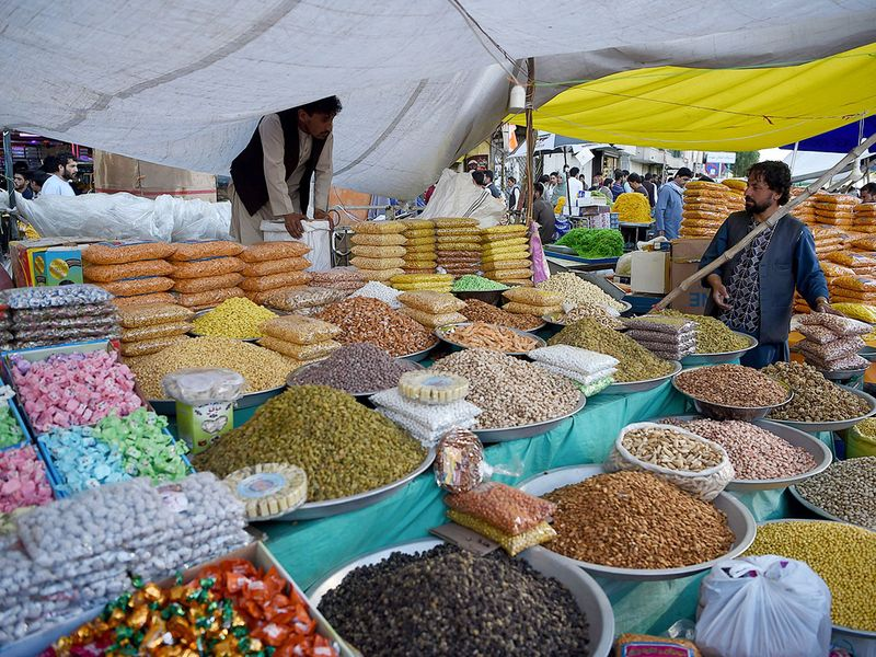An vendor sells dry fruits and sweets