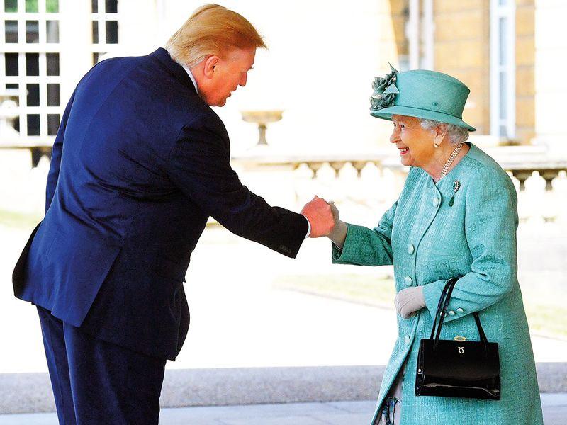 Britain's Queen Elizabeth II greets US President Donald Trump