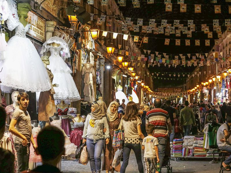 Syrians shop at the Hamidiya market