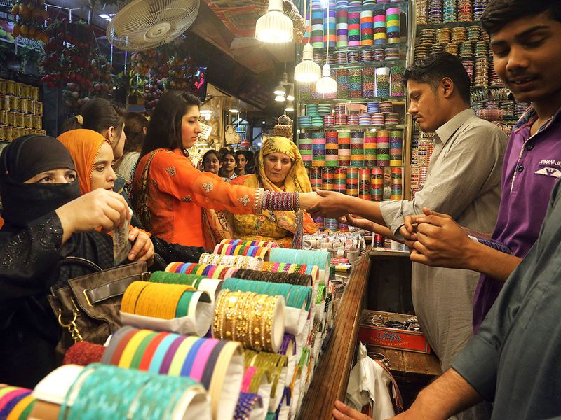 Women buy traditional bangles