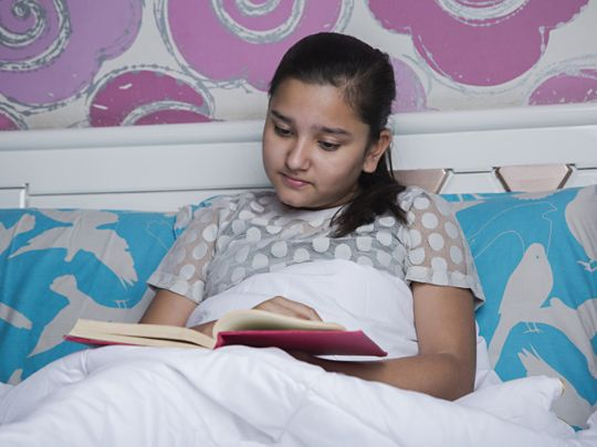 tab An Indian girls reading a book-1559558356169