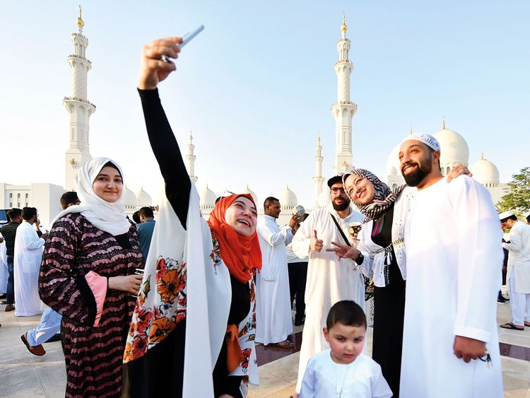 A family poses for a selfie after Eid prayers