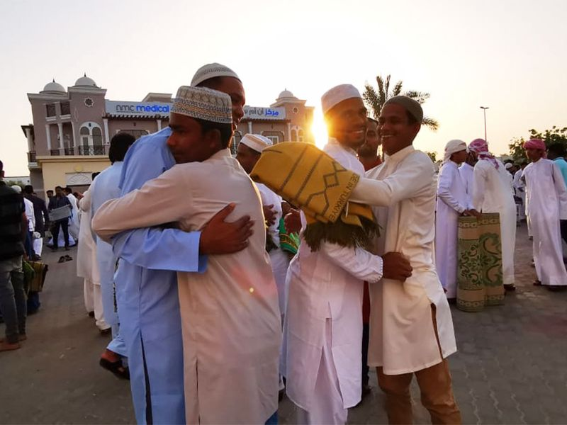 Friends greet eacher after the Eid prayers in Sharjah