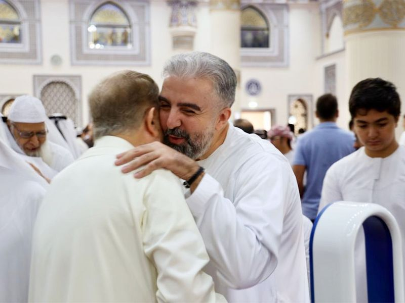 People greet each other for Eid Al Fitr