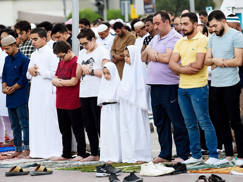 Worshippers offer Eid Al Fitr prayers at Al Noor Mosque