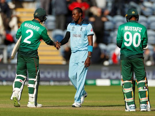 England's Jofra Archer shakes hands with Bangladesh's Mashrafe Mortaza after the match