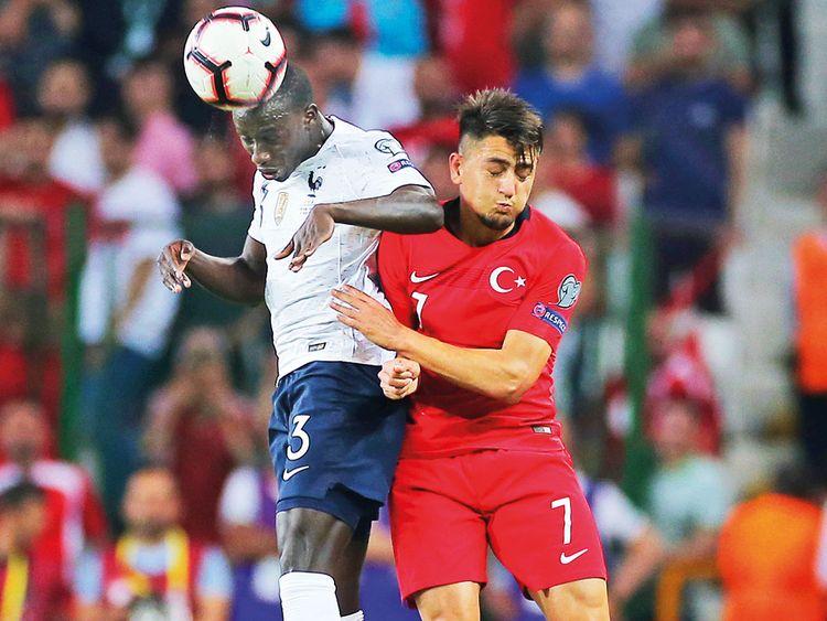 France defender Ferland Mendy (left) and Turkey's midfielder Cengiz