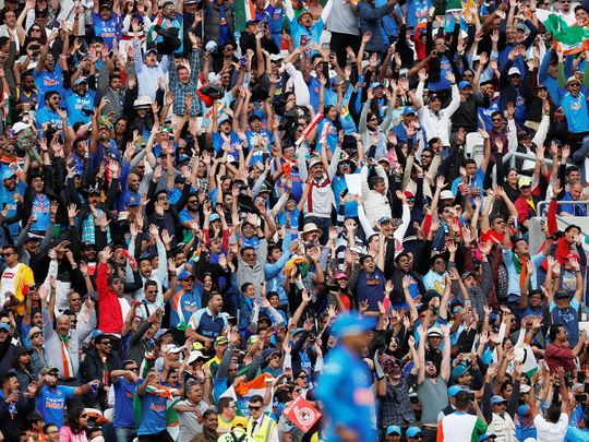 India fans celebrate during the match