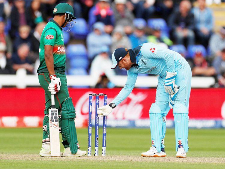 England's Jonny Bairstow inspects the stumps