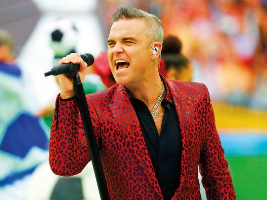 190614 Robbie Williams takes stake in college, sings mentoring's praises