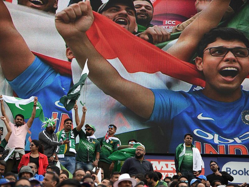 India and Pakistan supporters cheer on their teams
