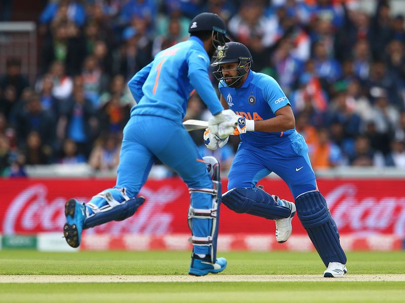 India's K.L. Rahul, left, and Rohit Sharma run between wickets