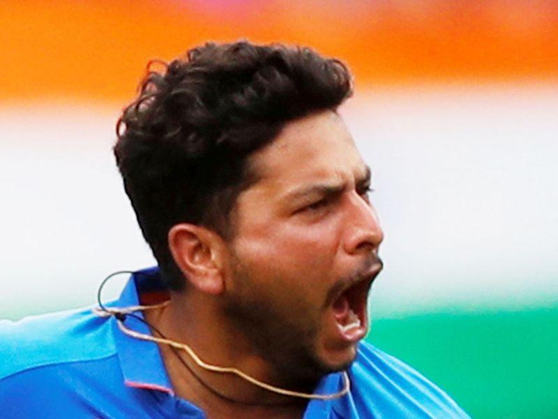 India's Kuldeep Yadav celebrates the wicket of Pakistan's Babar Azam