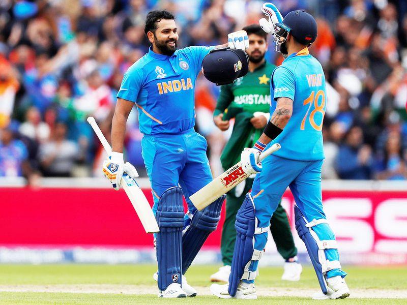 India's Rohit Sharma celebrates his century with Virat Kohli