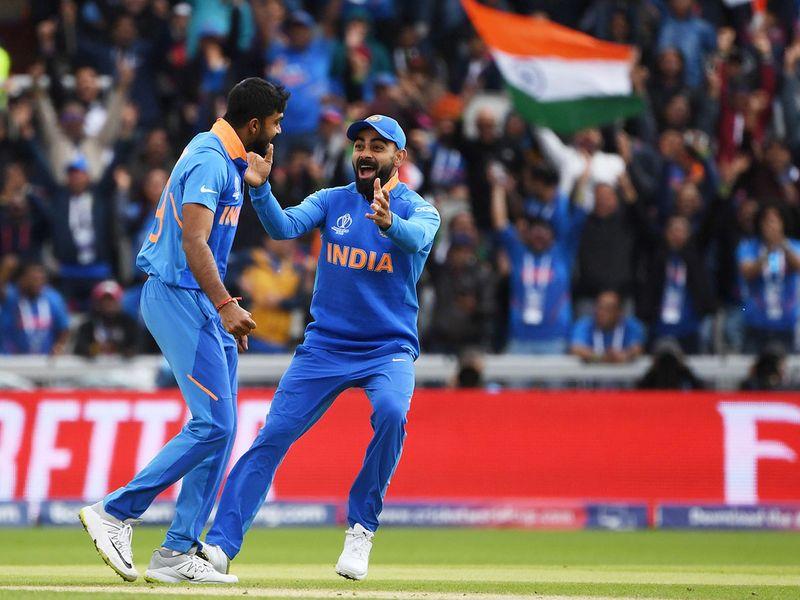 India's Vijay Shankar (L) celebrates