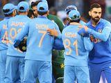 India's captain Virat Kohli (R) celebrates