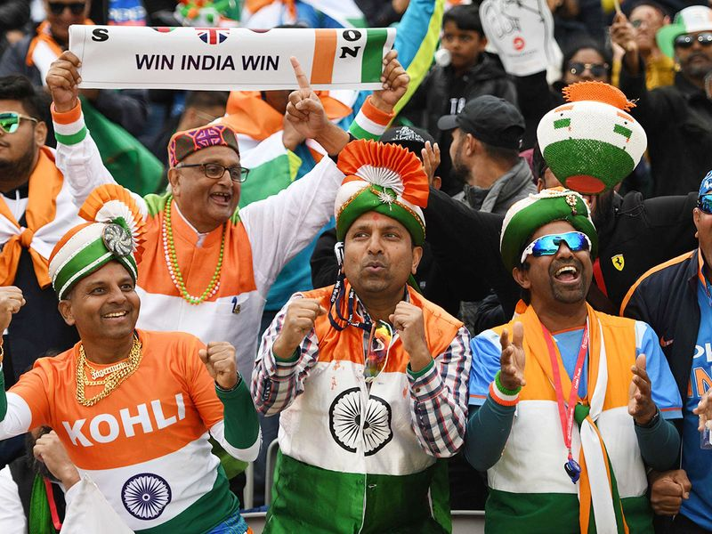 Indian supporters celebrate in the crowd