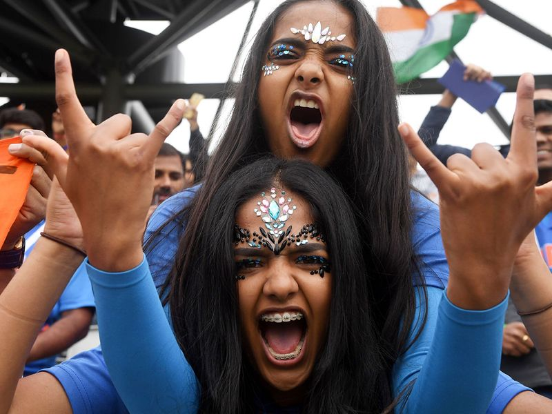 Indian supporters cheer