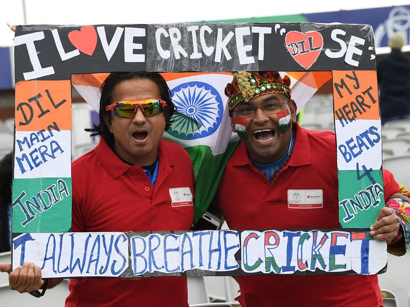 Indian supporters pose ahead of the match at Old Trafford in Manchester