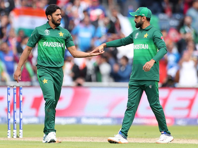 Pakistan's Hasan Ali, left, celebrates the dismissal of India's Rohit Sharma