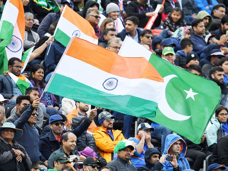 Spectators wave flags during the match