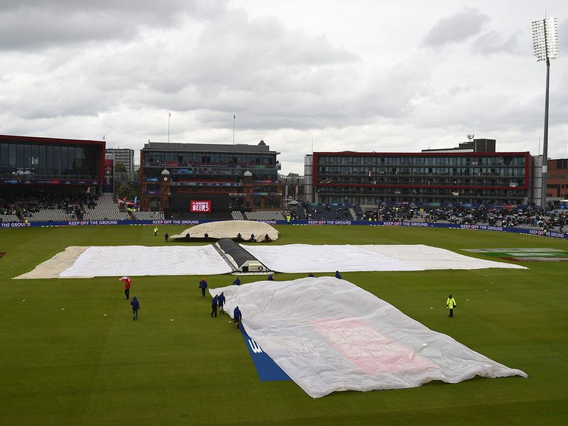 The covers and floodlights are on as rain stops play