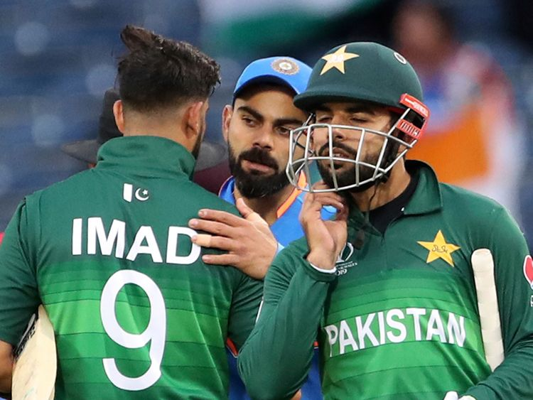 India's Virat Kohli greets Pakistan players