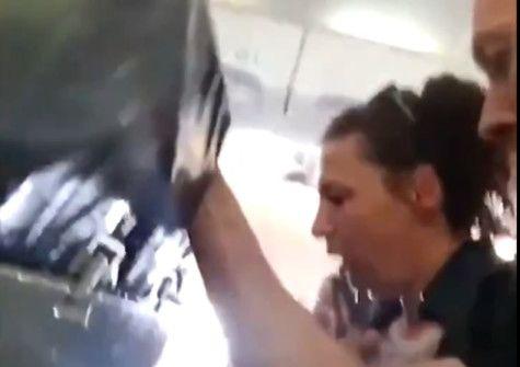 RDS_190618 Woman prays on flight-1560848411742