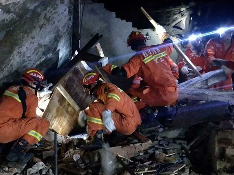 Rescuers search for earthquake survivors