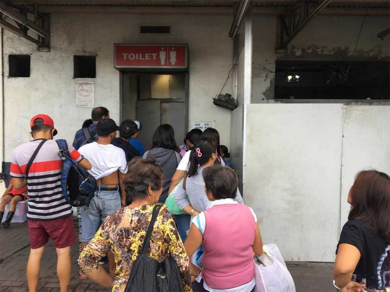 A queue outside a paid toilet 01