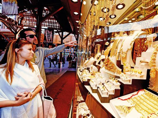 Customers look at jewellery in the Deira Gold Souq